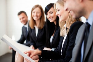Group of HR professionals reading a document